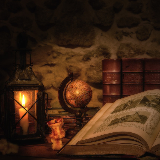 Old book dark room candle