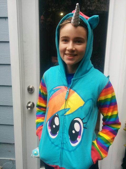 girl wearing rainbow dash my little pony hoodie zipper top and unicorn horn