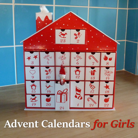 Red and white Advent calendar house with drawers to open and a Santa Claus