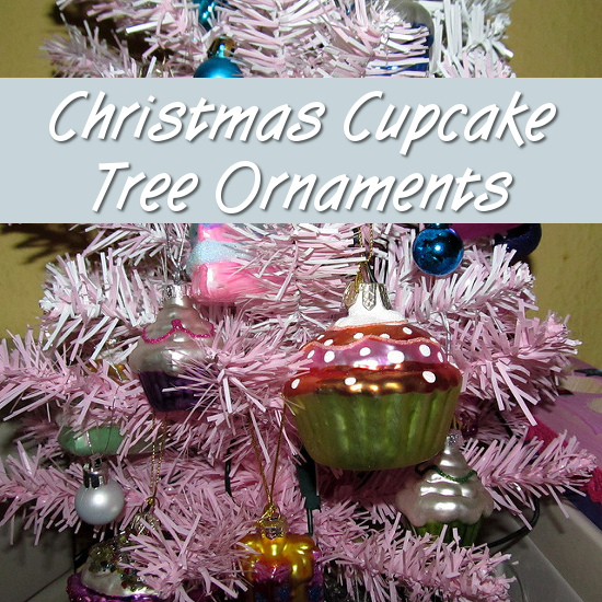 pink and white Christmas tree with cupcake ornaments hanging from it