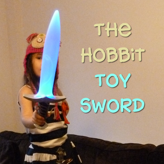 child with toy Bilbo Baggins sword lights and sounds play version