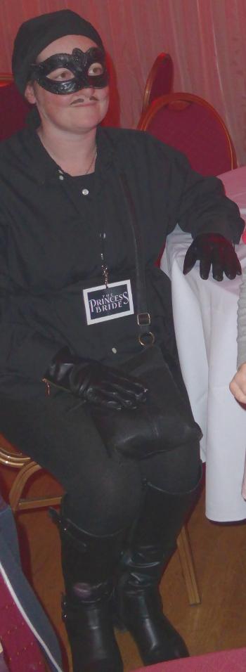 woman cosplayer wearing a Westley Princess Bride DIY costume