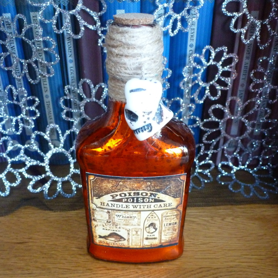 Orange glass Halloween potion bottle handle with care skull detail