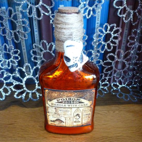 Orange glass Halloween potion bottle handle with care skull detail