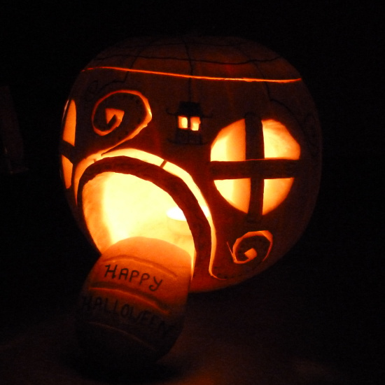 fairy pumpkin lit up with candles inside black and orange colors Halloween
