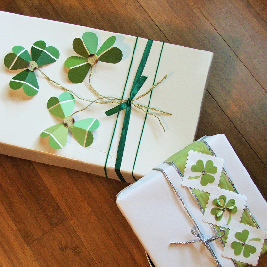 gift wrapped boxes for St. Patrick's day with green shamrock designs