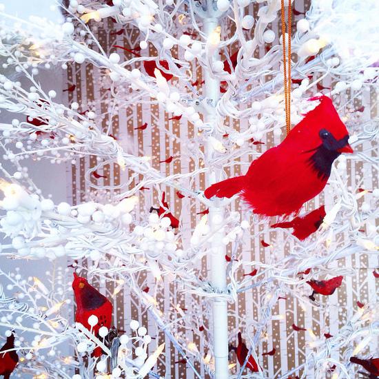 Red Cardinal bird on a white Christmas tree