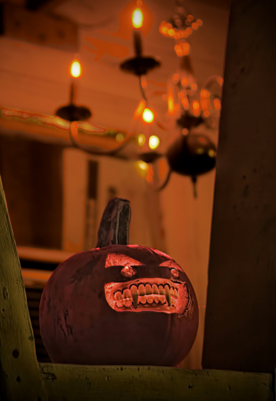 Halloween pumpkin with lamps lit in an orange color glow