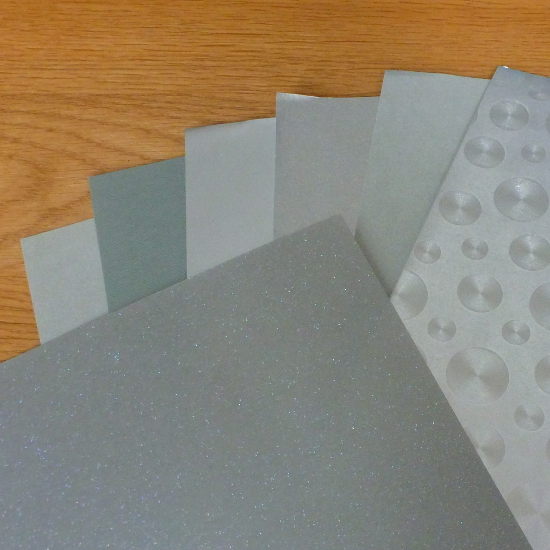 Silver color paper selection for paper crafts Christmas seasonal Holiday sparkling