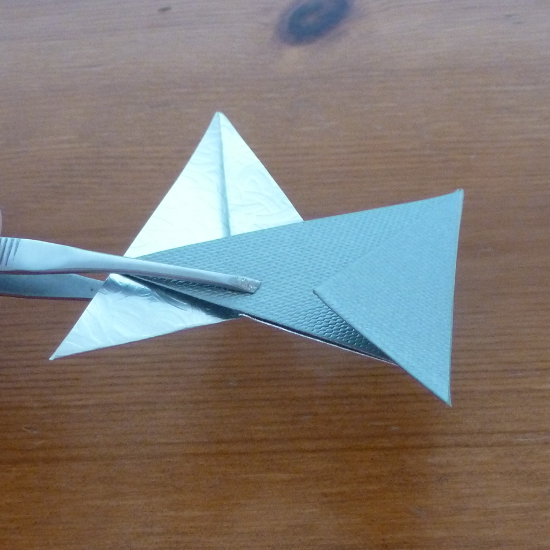 sticking folded papers together how to make a christmas star with paper