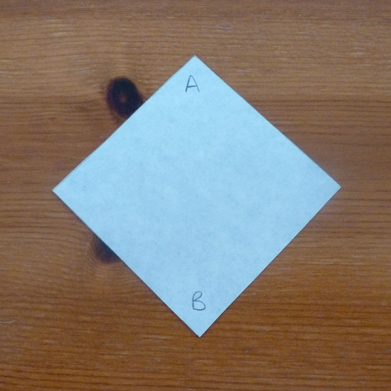 paper square with a and b written on it