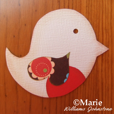 Bird cut from Bazzill cardstock with patterned wing