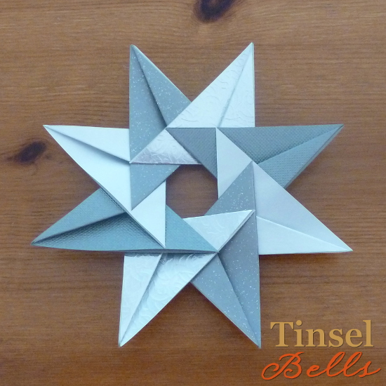 silver paper folded tea bag star origami style folding craft