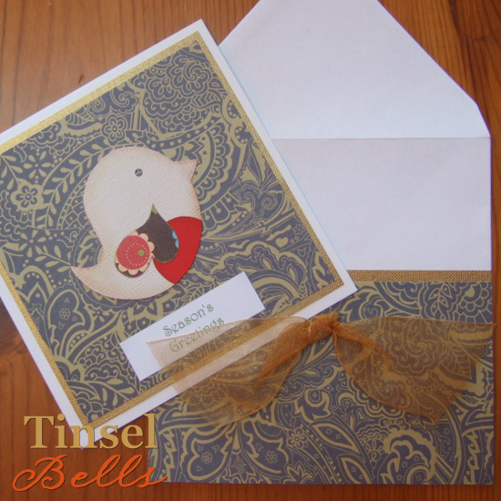 Patterned handmade Christmas greetings card with bird design green gold colors