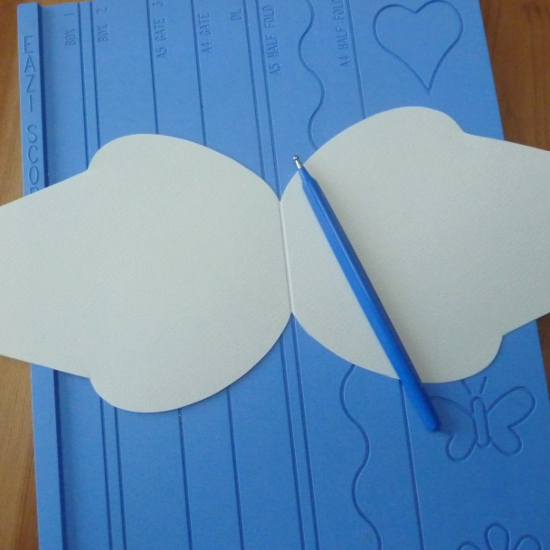 Making the cupcake shaped greeting card scoring the middle