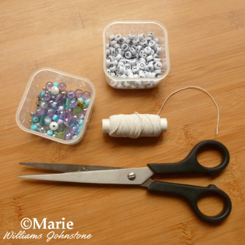 Supplies to make a simple alphabet bracelet craft for kids Scissors, beads, alphabet beads and elastic