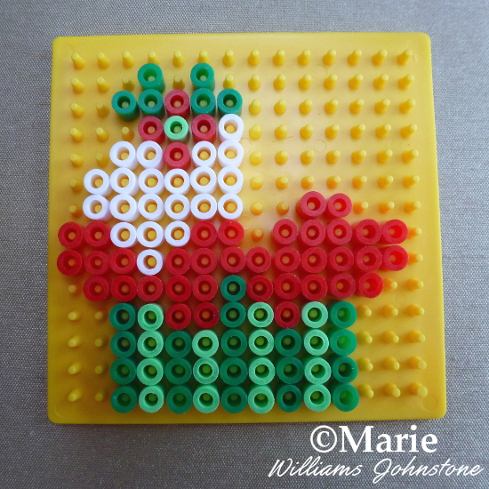 Adding in the little Holly section on the Christmas Perler cupcake pattern