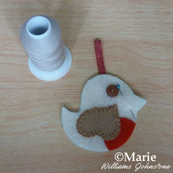 Turning a whimsical bird into a hanging decoration for the festive Holiday season