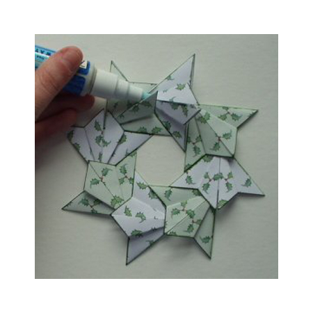 Sticking together the paper folded origami wreath