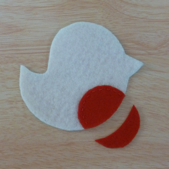 Front piece of the felt fabric bird with red Robin section festive craft