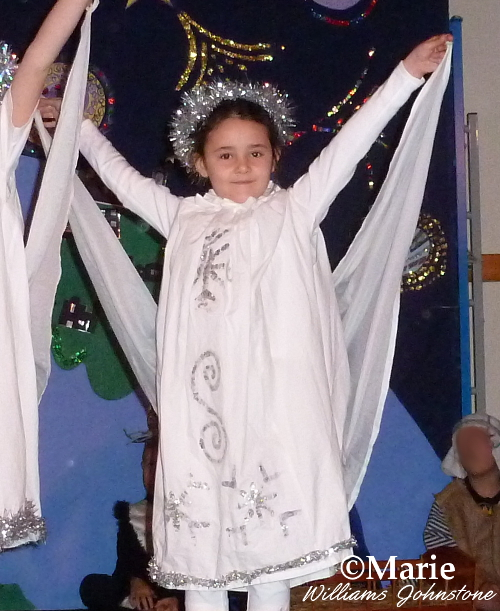 Pretty child angel in Christmas festive nativity play