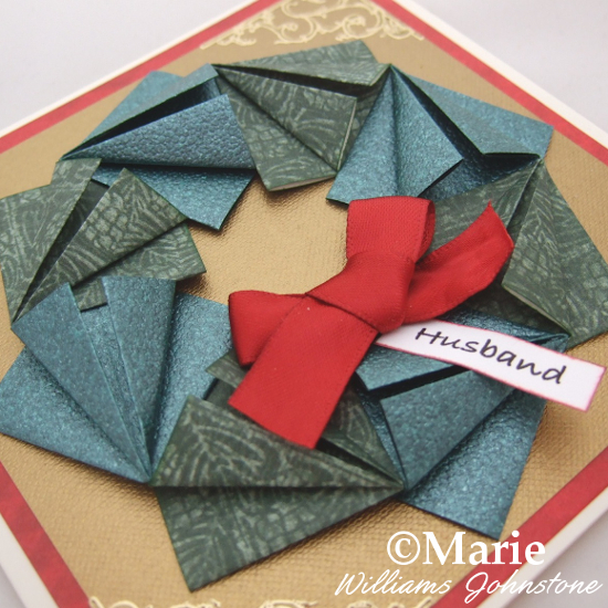 Festive Christmas Origami Paper Folding Wreath Design for a Card