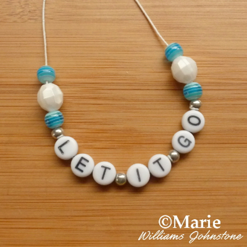 Letter wording alphabet beads spelling Let it Go from Frozen stringing bracelet Disney Frozen winter design craft kids